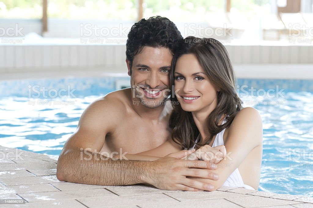 Loving couple at spa pool stock photo