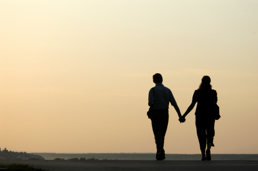 Loving Couple At Sunset Stock Photo - Download Image Now
