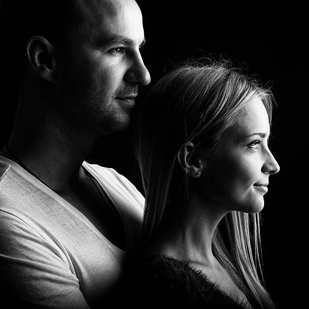 Loving couple, black and white profile picture stock photo