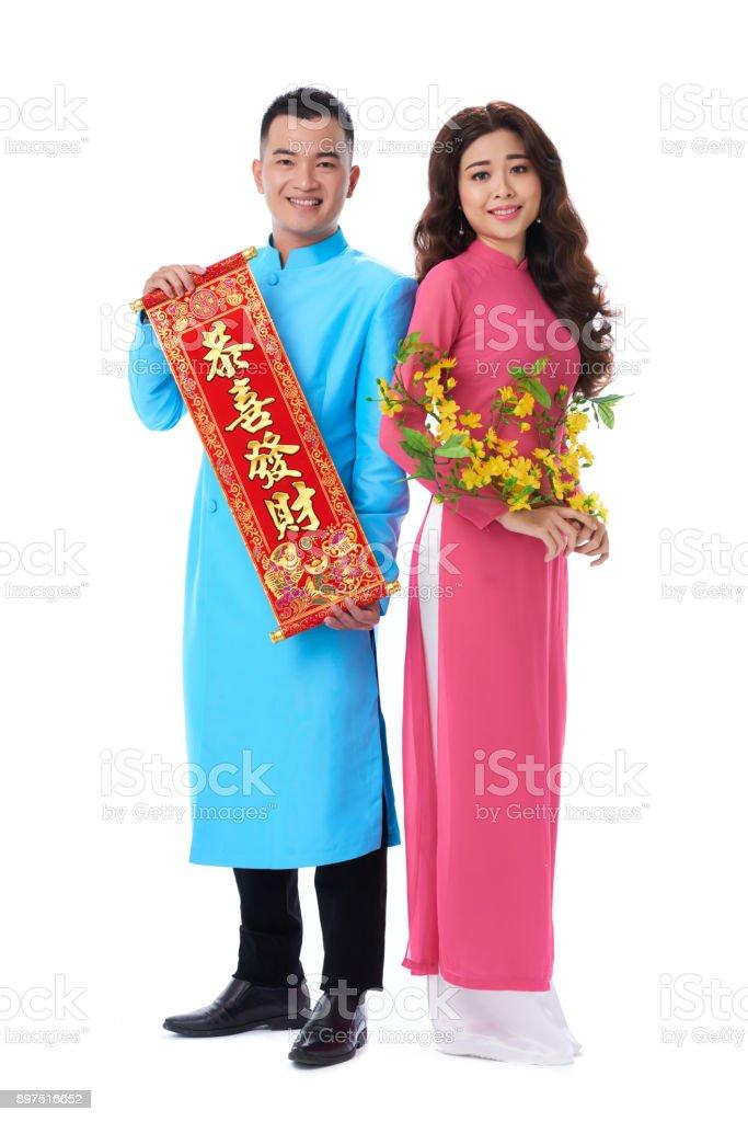 Loving Couple Celebrating Tet Holiday stock photo