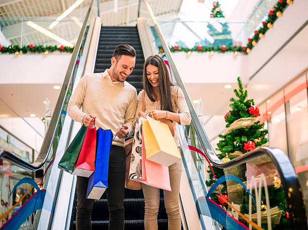 Loving couple doing Christmas shopping together stock photo