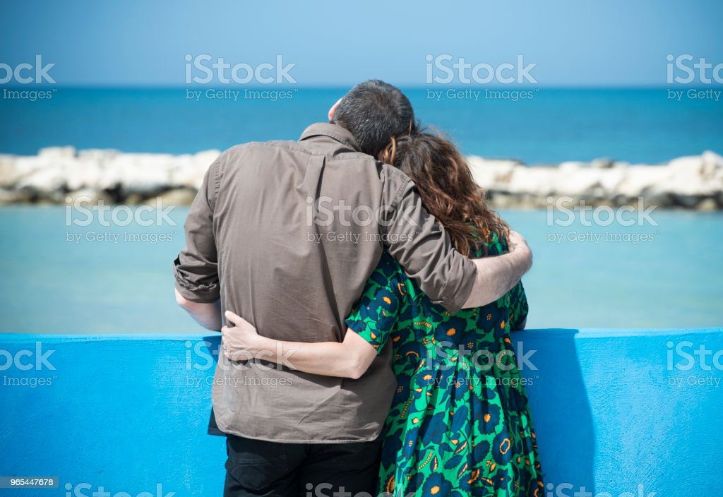 Loving Couple Embraced look at the sea royalty-free stock photo