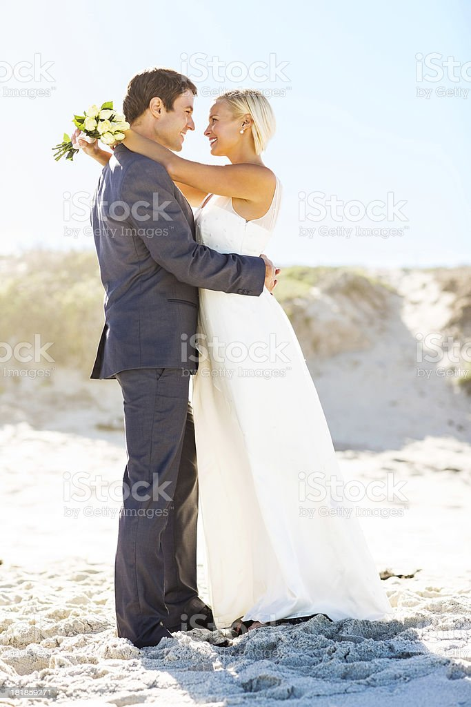 Loving Couple Embracing Each Other On Beach royalty-free stock photo