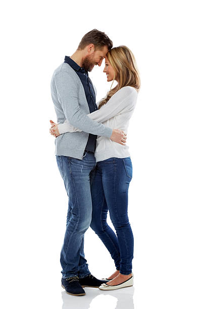 Loving couple embracing over white stock photo
