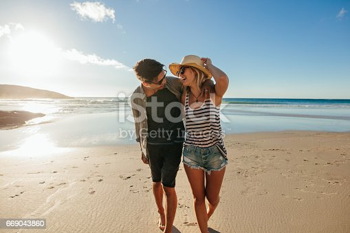 istock Loving couple enjoying a day on beach 669043860