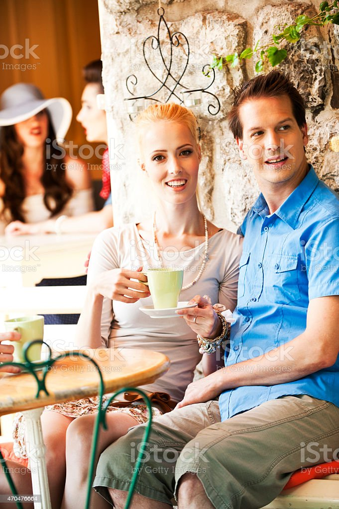 Loving couple enjoying coffee stock photo