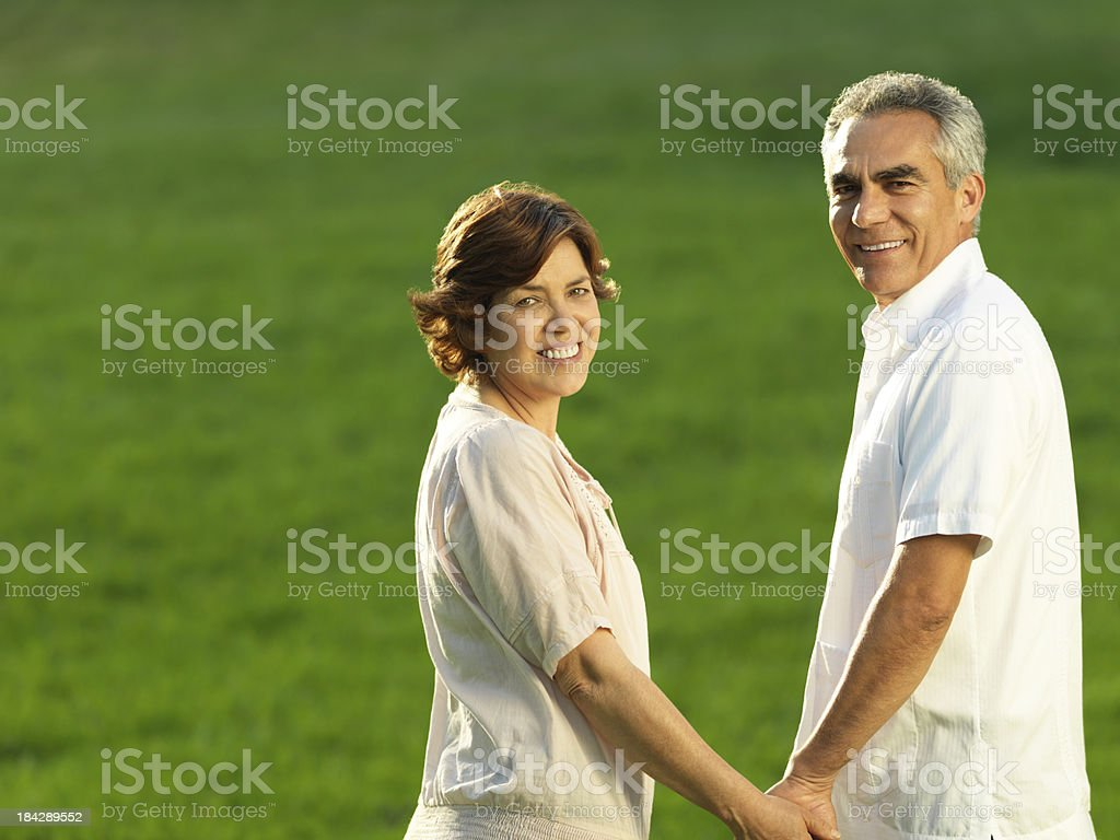 Loving couple holding hands royalty-free stock photo