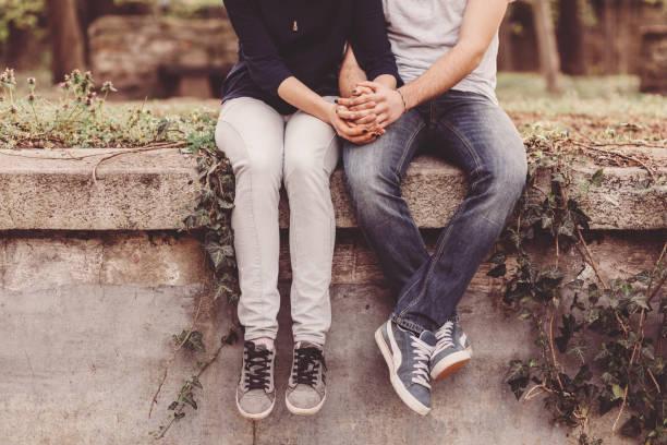 loving couple holding hands  - junges paar stock-fotos und bilder
