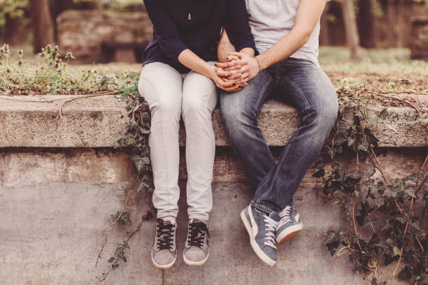 Loving couple holding hands stock photo