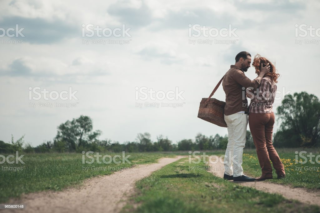 Loving couple hugging on the grassland - Royalty-free Adult Stock Photo