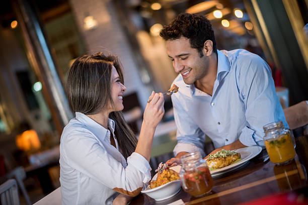 Loving couple in a romantic dinner - Photo