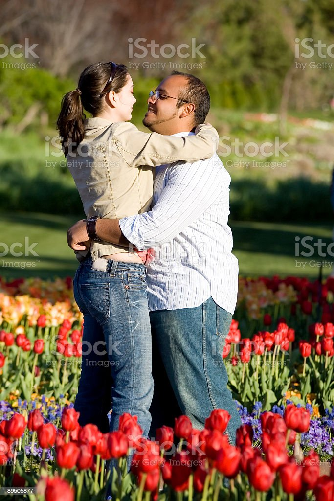Loving Couple in Field of Tulips royalty-free stock photo