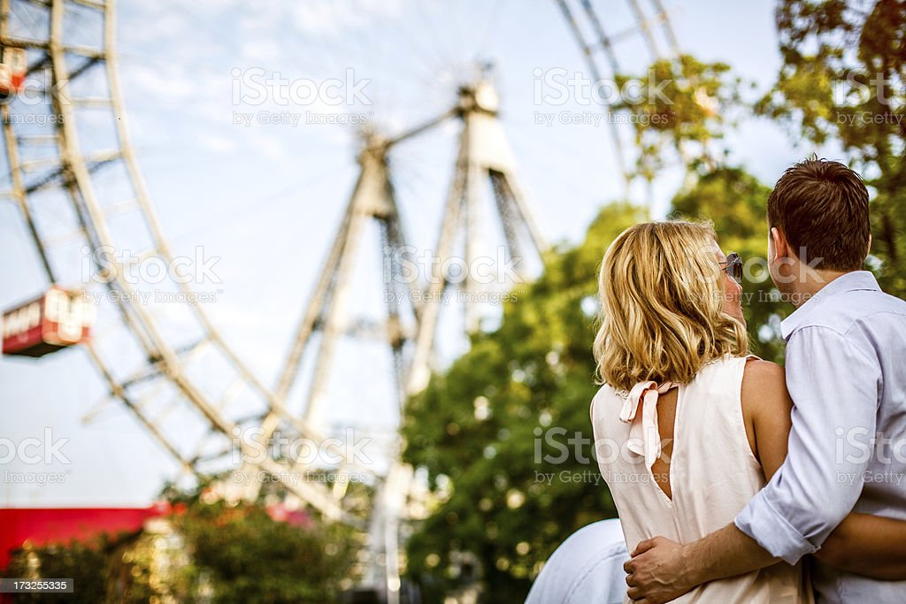 Loving couple in front of Vienna Prater royalty-free stock photo