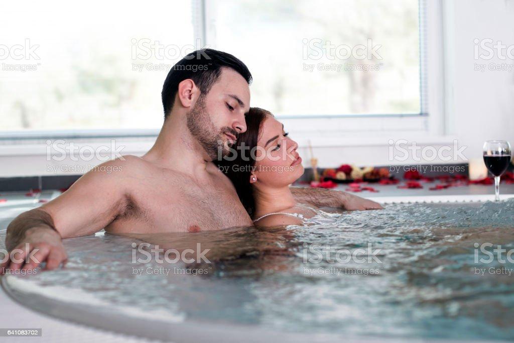 Loving couple in jacuzzi stock photo