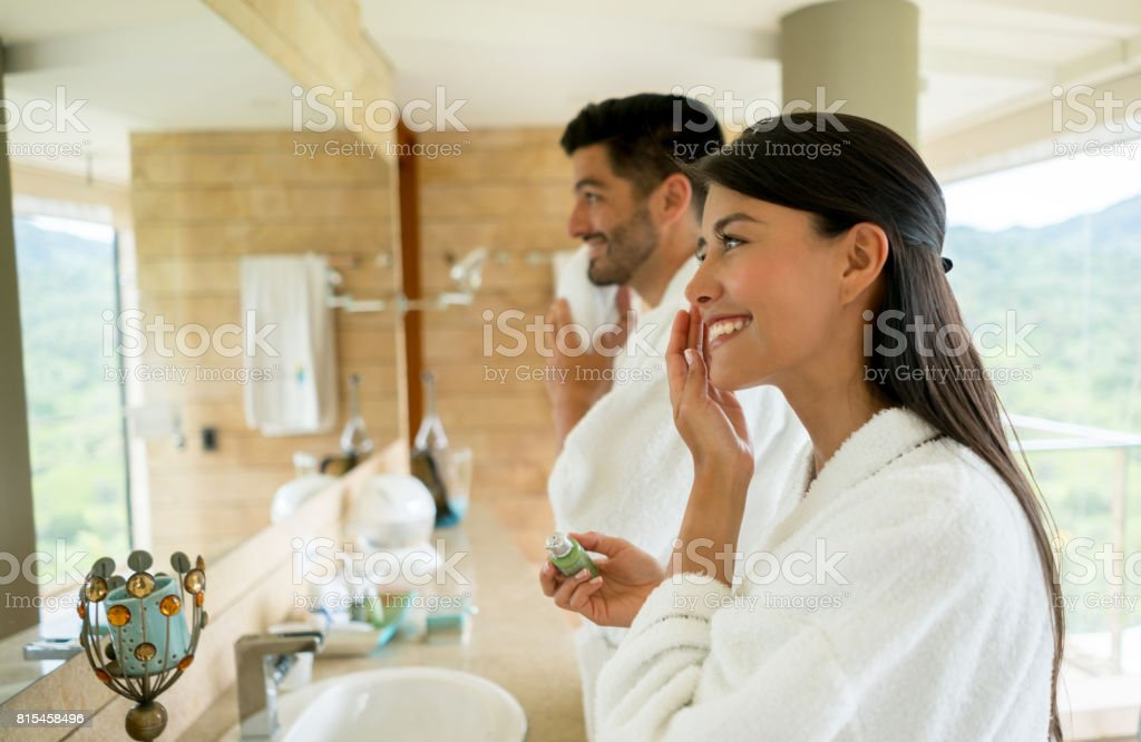 Loving couple in the bathroom getting ready in the morning stock photo