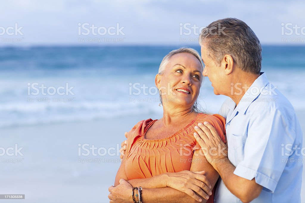 Loving couple in the beach on vacations royalty-free stock photo