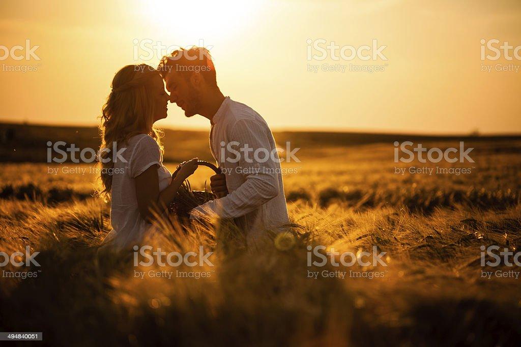 Loving couple in wheat field stock photo