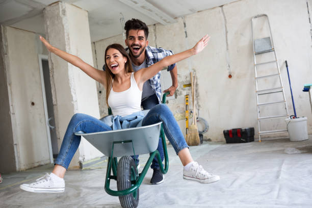 Loving couple is having fun while they are renovating house stock photo