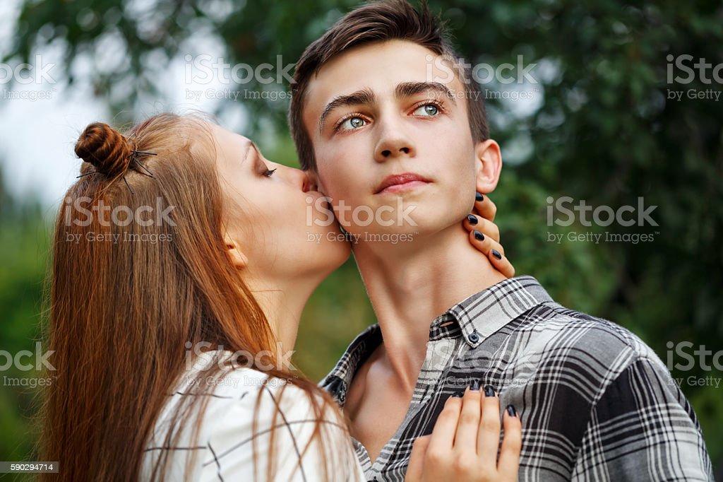 Loving couple kiss teenagers. Стоковые фото Стоковая фотография
