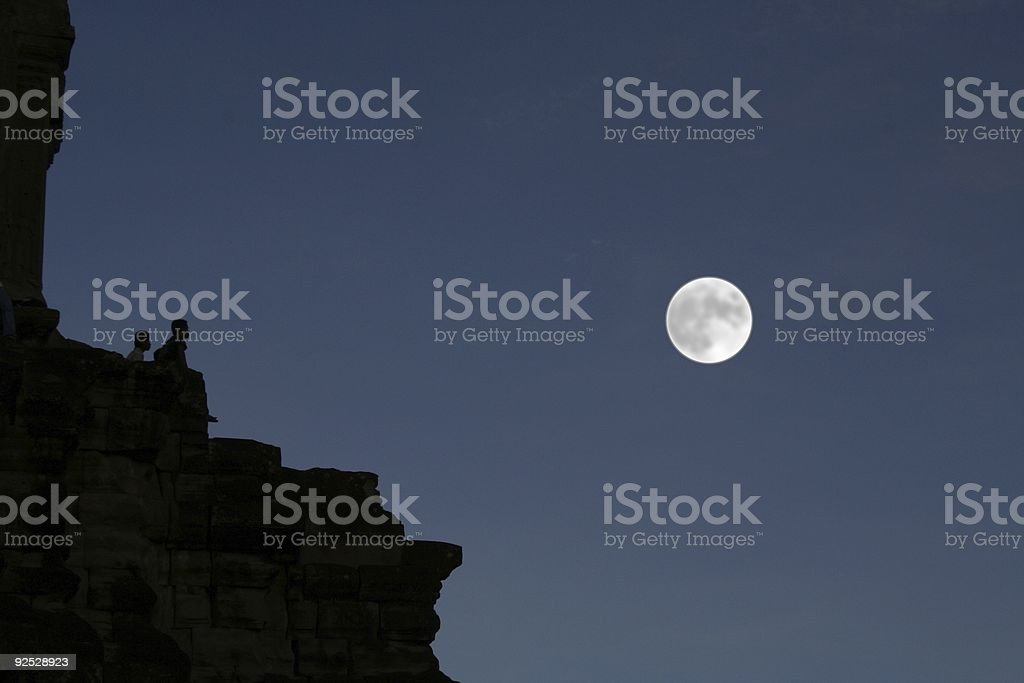 loving couple looking at the moon stock photo