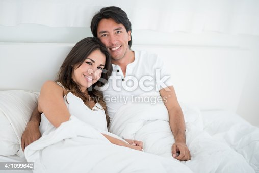 istock Loving couple lying in bed 471099642