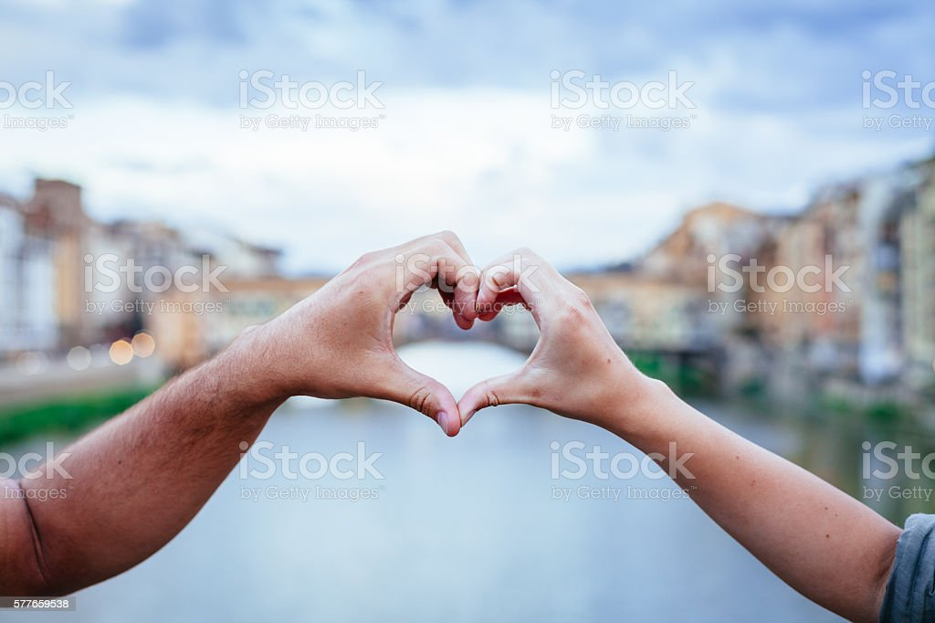 Loving couple making heart with her hands in Florence – Foto