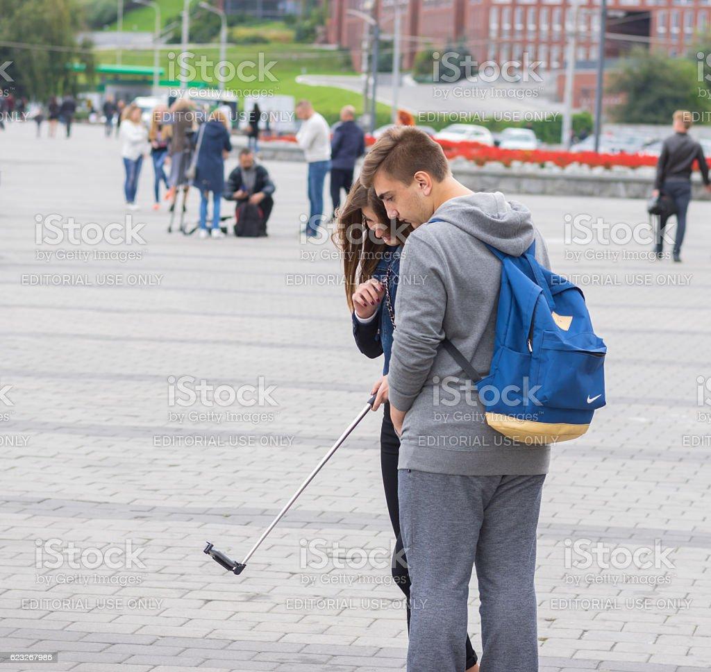 Loving couple of teenagers making selfie stock photo