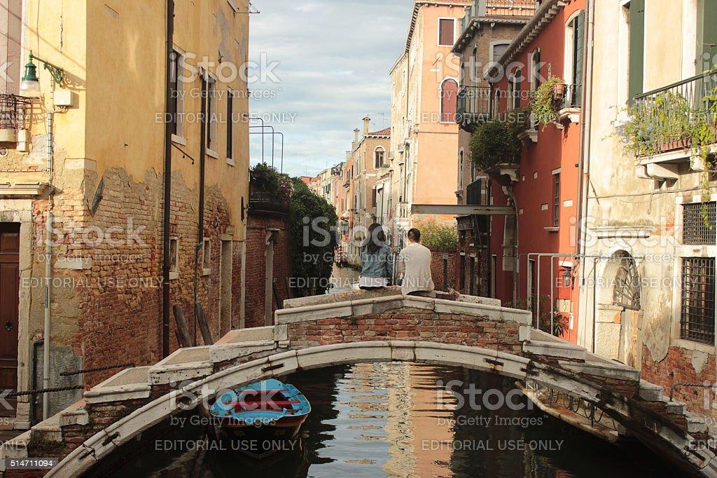 Loving couple on the bridge in Venice stock photo