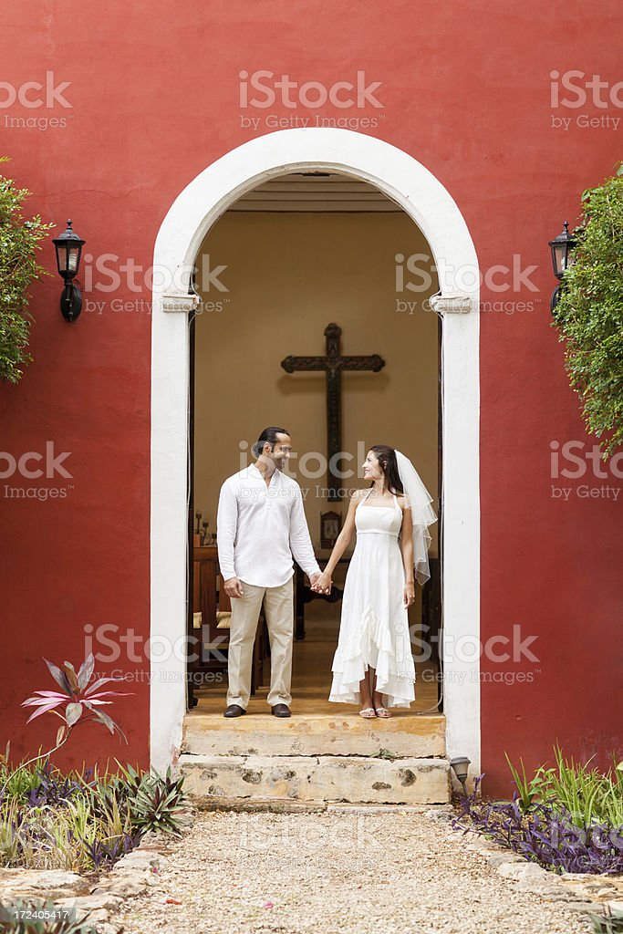 Loving couple outside a church royalty-free stock photo