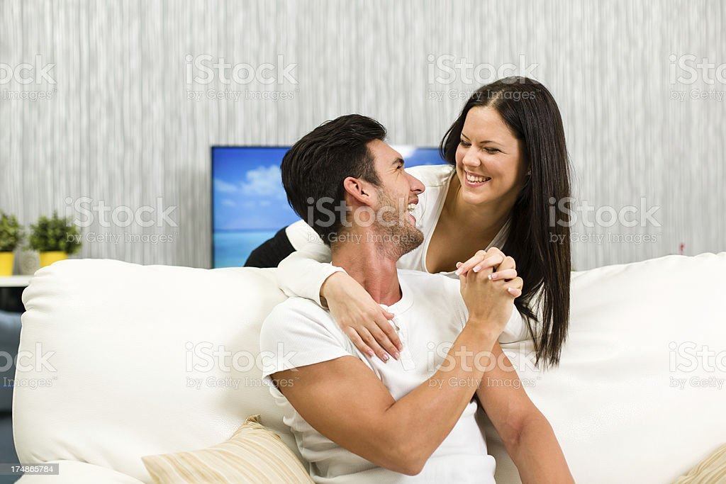 Loving couple relaxing at home royalty-free stock photo