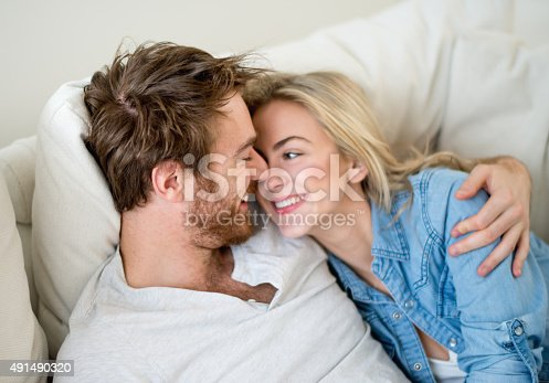 istock Loving couple relaxing at home 491490320