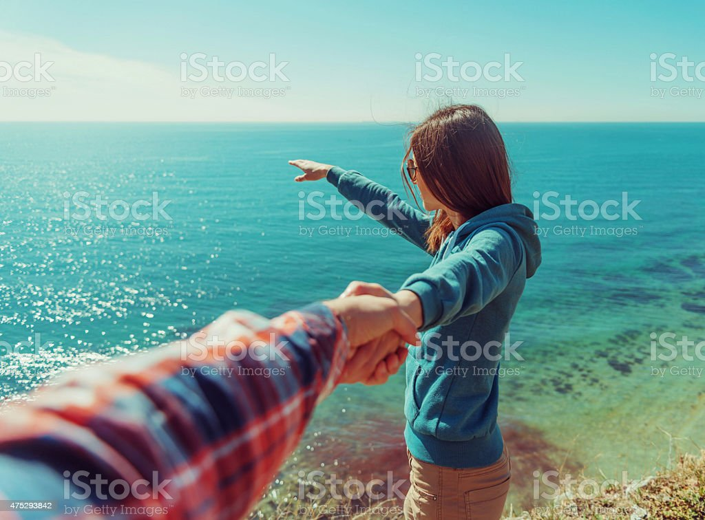 Loving couple resting on beach stock photo