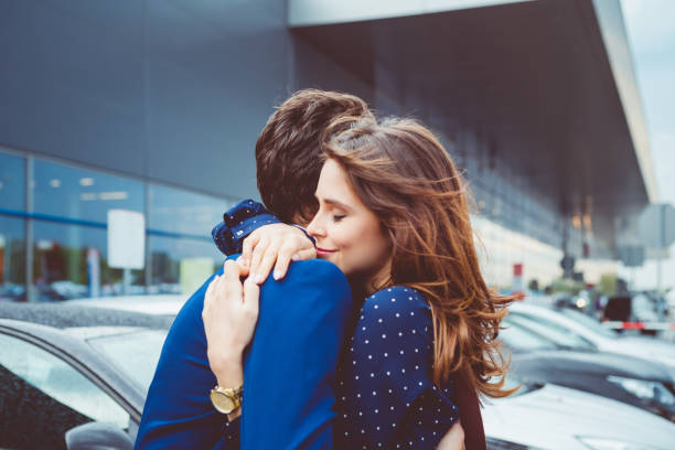 loving couple say good bye at airport stock photo