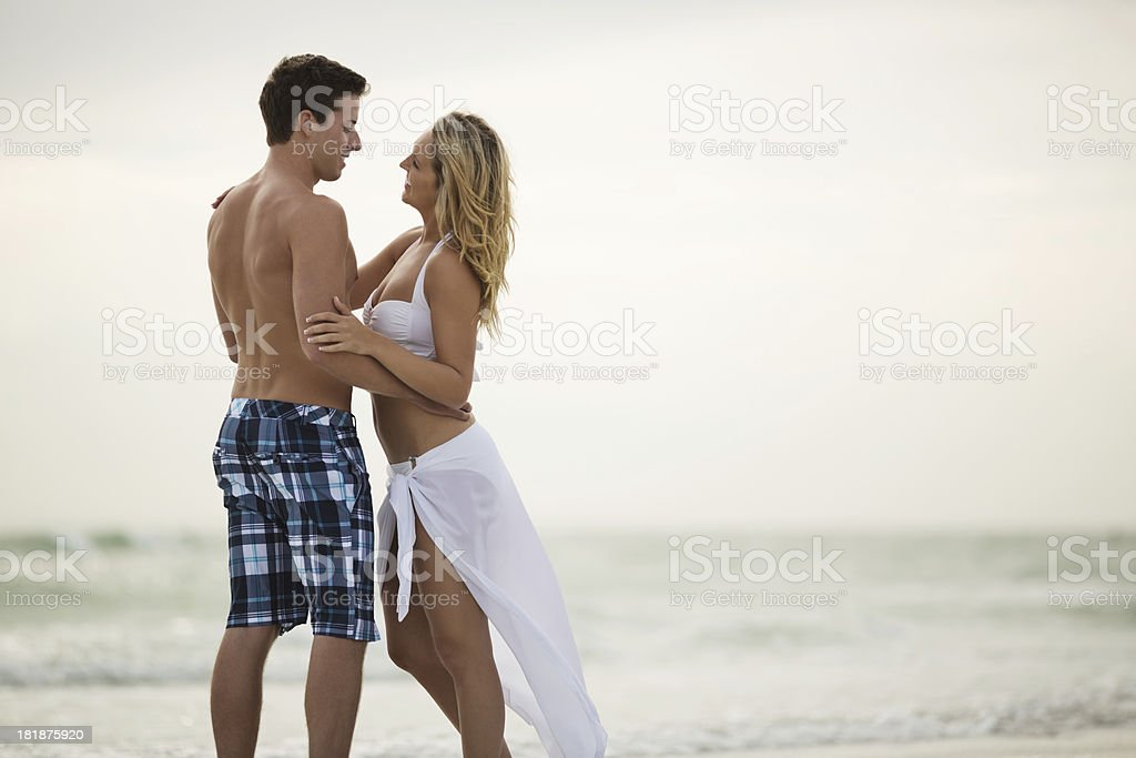 Loving Couple Standing Against Clear Sky royalty-free stock photo