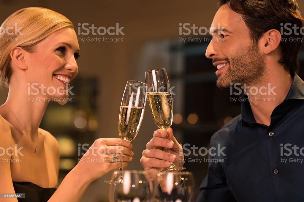 Loving couple toasting stock photo