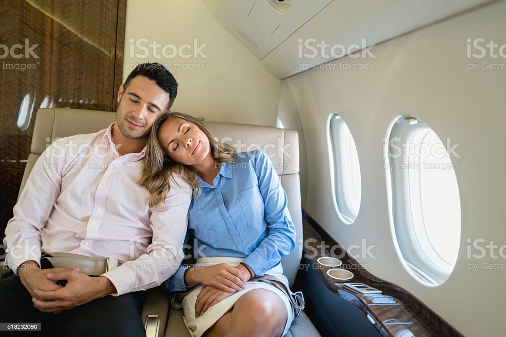 Loving couple traveling in business class - Photo