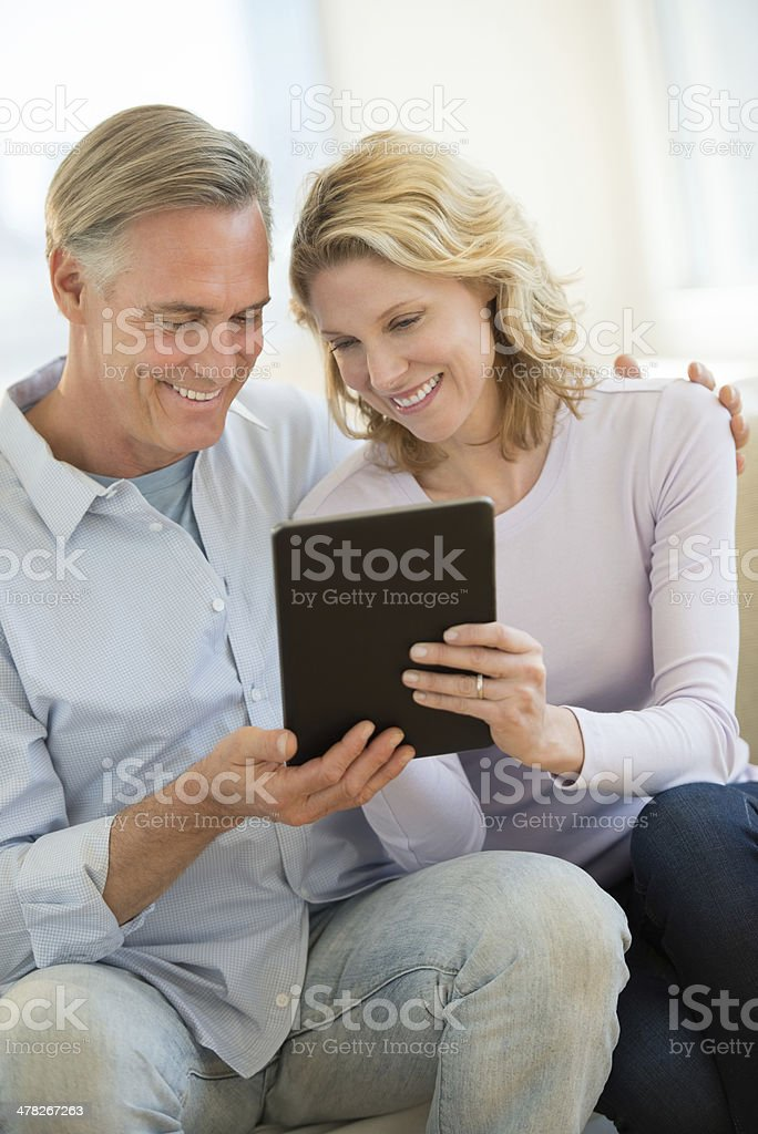 Loving Couple Using Digital Tablet At Home royalty-free stock photo