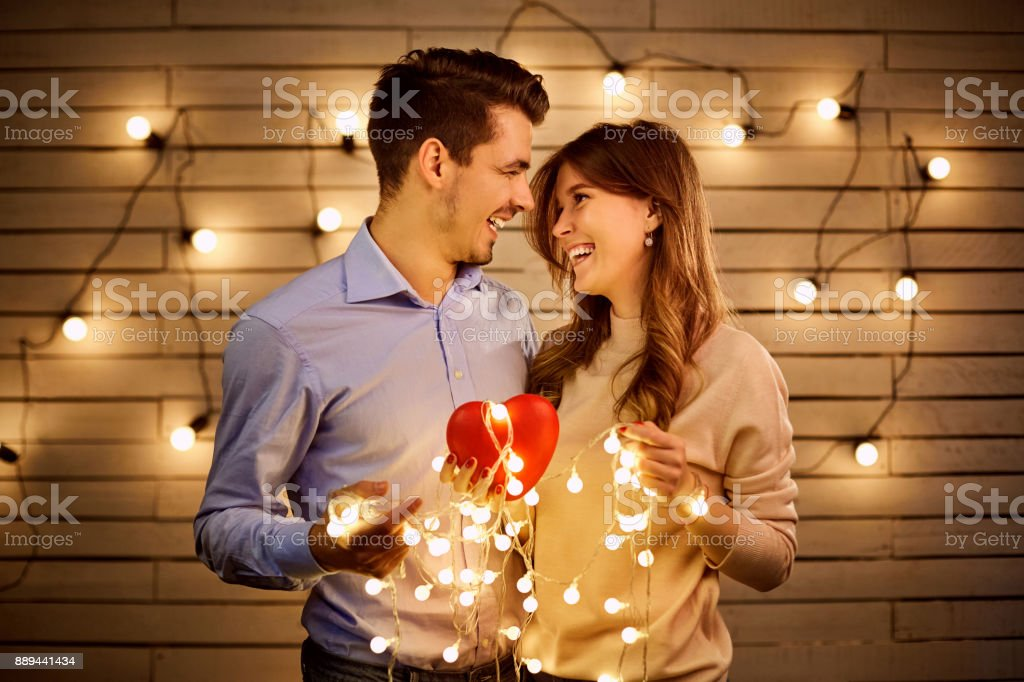 A loving couple with a heart. stock photo
