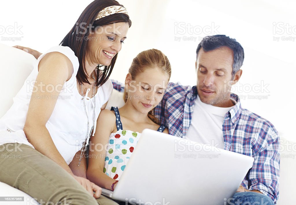 Loving family browsing the internet together royalty-free stock photo