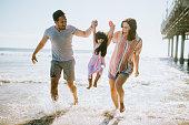 istock Loving Family Enjoying Sun at Los Angeles Beach 1266365034