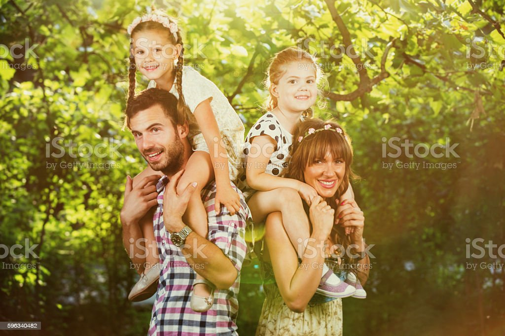 Loving family having fun on spring day in nature. royalty-free stock photo