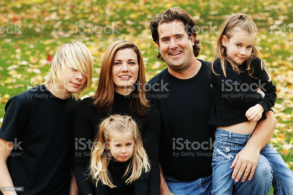 Loving Family in Fall Park Together royalty-free stock photo