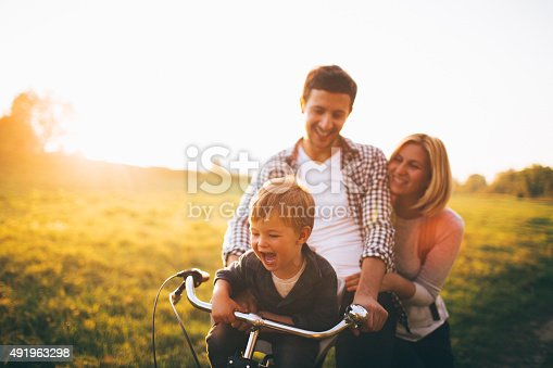 istock Loving family on a bicycle 491963298