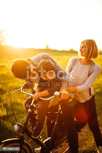 istock Loving family on a bicycle 491963442