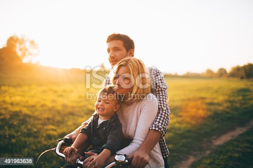 istock Loving family on a bicycle 491963638
