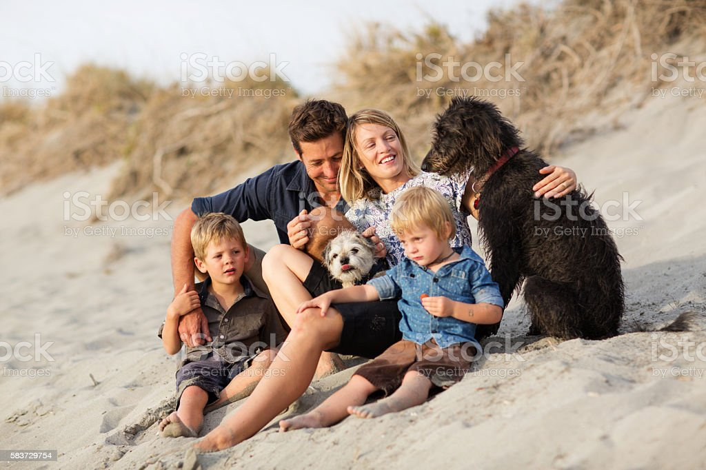Loving Family with Dogs stock photo
