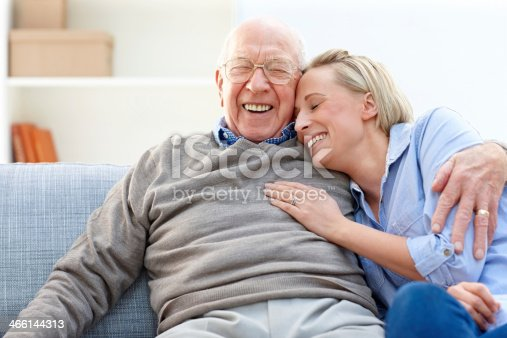 istock Loving father and daughter together on sofa 466144313