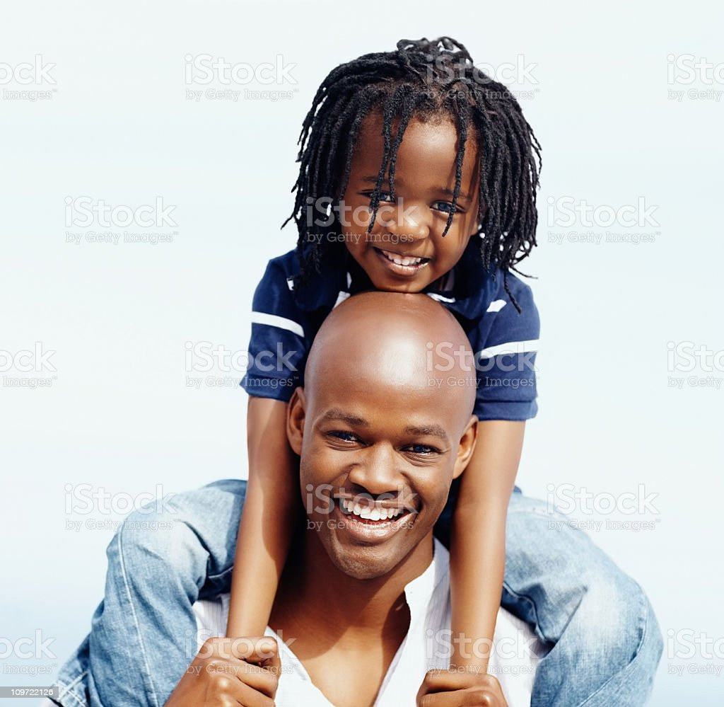 Loving father carrying his son the shoulders royalty-free stock photo