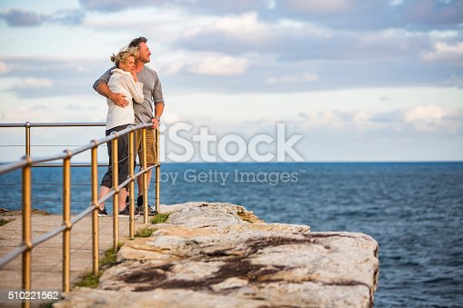 istock Loving Happy Middle Aged Fit Healthy Beach Couple at Sunset 510221562