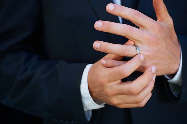 loving his ring - human finger stock pictures, royalty-free photos & images